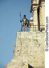 Knight on the tower - Armoured knight standing on the castle...