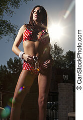 Red White Polka Dot Bikini - A bikini model posing in an...