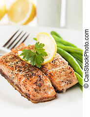 Grilled salmon steak with lemon and herbs