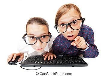 Young girls playing or working on a computer - Two girls...