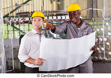 factory manager and worker discussing about production plan