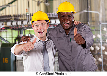 factory manager and worker thumbs up