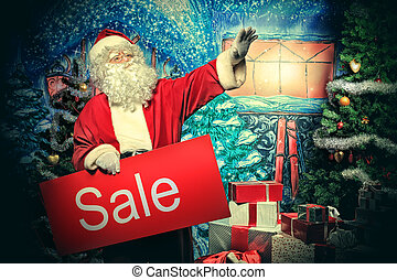 declare - Santa Claus holding sale board over Christmas...