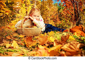 leafage - Portrait of a cute girl with a basket full of...