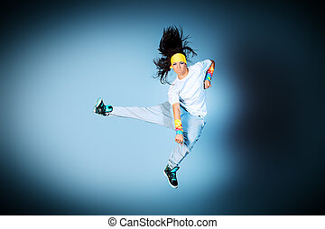 cool dance - Young woman dancing hip-hop at studio