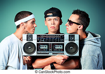 youth man - Group of trendy teenagers posing with boombox at...