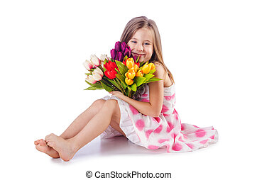 Cute little girl with flowers on white