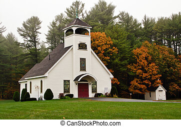 White chapel in New England on a foggy day