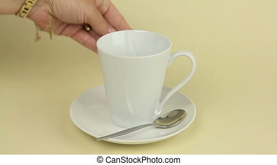 Tea Bag 1 - A mug of tea prepared with a tea bag and boiling...