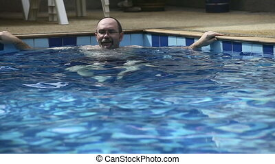 Man in pool.