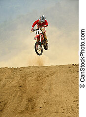 motocross bike in a race representing concept of speed and...