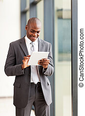 african american businessman with tablet computer in office