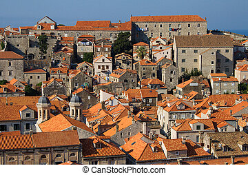 Panorama of Dubrovnik roofs in Croatia at sunrise, travel background