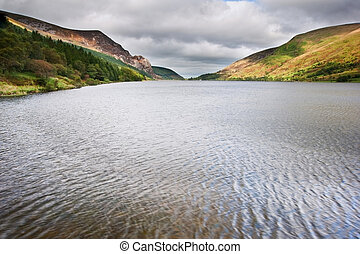 View over Llyn Cwellyn towards mountains in distance in...