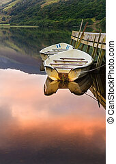 Sunrise reflected in calm water of Llyn Nantlle at sunrise...