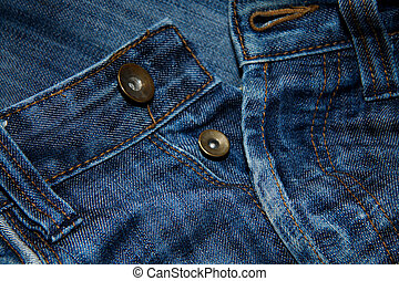 Close up of blue jeans with buttons