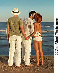 woman cheating on boyfriend by sea shore - young woman...