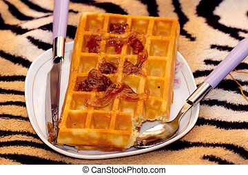 Close-up of waffle and knife, spoon