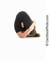 adavanced contorted yoga pose - young woman in yoga pose,...