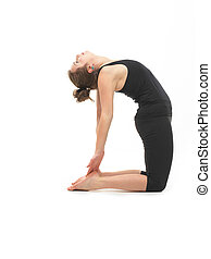 woman in reversed yoga posture - young attractive woman in...