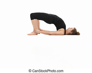 woman demonstrating yoga posture - young attractive...