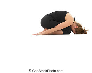 relaxing yoga posture - young woman in relaxing yoga pose,...