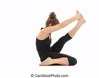 young woman in yoga posture - white woman dressed in black,...