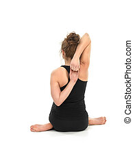 yoga pose by young woman - attractive young woman in...
