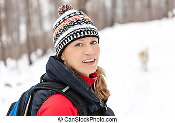 Woman hiking in winter forest