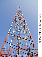 Telecommunications tower on blue sky background