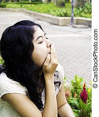 Yawning tired woman
