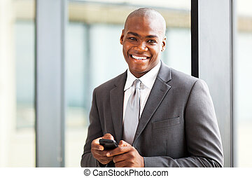 handsome african american businessman using a smart phone