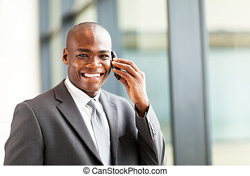 successful african businessman talking on cell phone