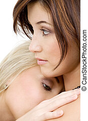 girlfriends - intimate picture of two lovely girls cuddling