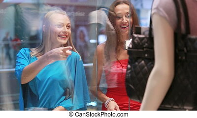 Window shoppers - Excited girls admiring the view in the...