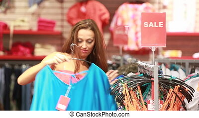 Lovely shopaholic - Excited shopping girl rummaging through...