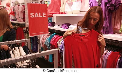 Shoppers - Beautiful female shoppers looking for stylish...