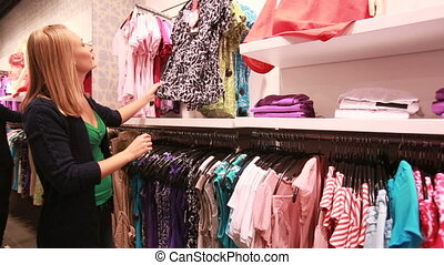 Shopping time - Pretty blonde woman enjoying her shopping...