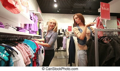 Friendly advice - Female friends doing shopping together...