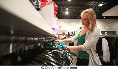 Shopping as a hobby - Beautiful blonde girl enjoying her...