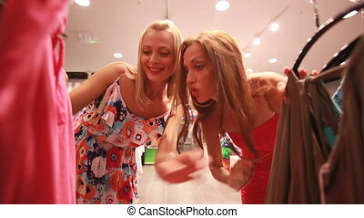 Among the racks - Excited girls doing shopping on a spree...