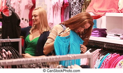 Happy in shopping - Positive young women spending time in a...