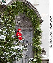 Manneken Pis as Santa - Famous statue of Manneken Pis in...