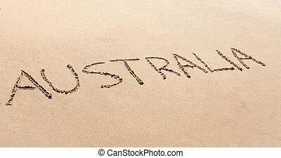Australia written in the sand on a beach - Australia written...