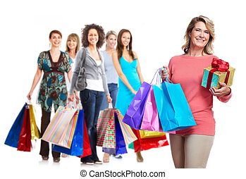 Senior woman with shopping bags Isolated over white...
