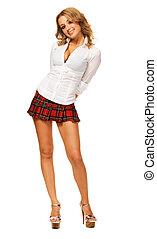 Lovely sexy girl in checkered short skirt against white...