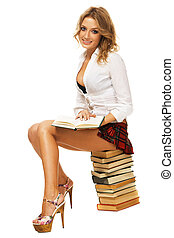 Sexy student girl with a stack of books against white...