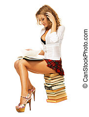 Sexy student girl with a stack of books - Sexy student girl...