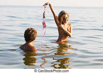 Sexy girl undressing in the water with boyfriend - Pretty...