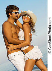 Young stylish couple on a sea shore - Young beautiful couple...